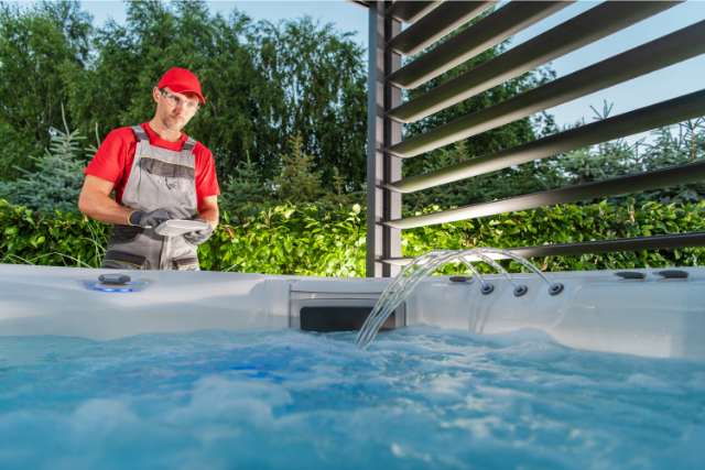 Hillsboro Hot Tub worker testing the water system
